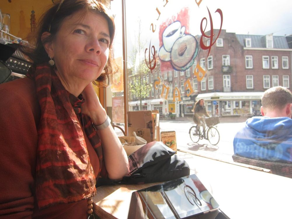 Susie in the window of a cafe, waiting for a bagel