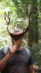 Jordo holding dry stag horn leaf over his face
