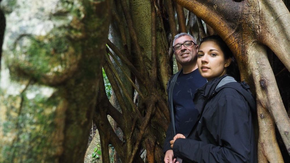 Ruby and Jordo inside the roots of a giant Strangler Fig