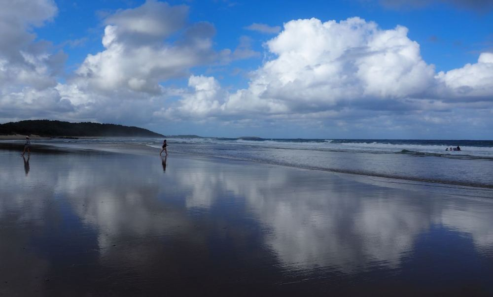 Sawtell beach with clouds reflected in wet sand