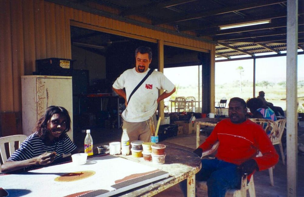 One of the artists at work, with Mark Nodea (right)