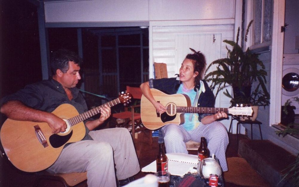 Photo of Chris and Sharon playing guitars