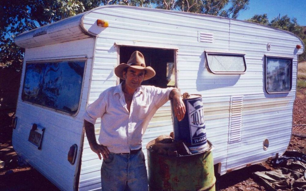 """Gum tree 69"" (photo of Jimmy Hooker next to his caravan)"