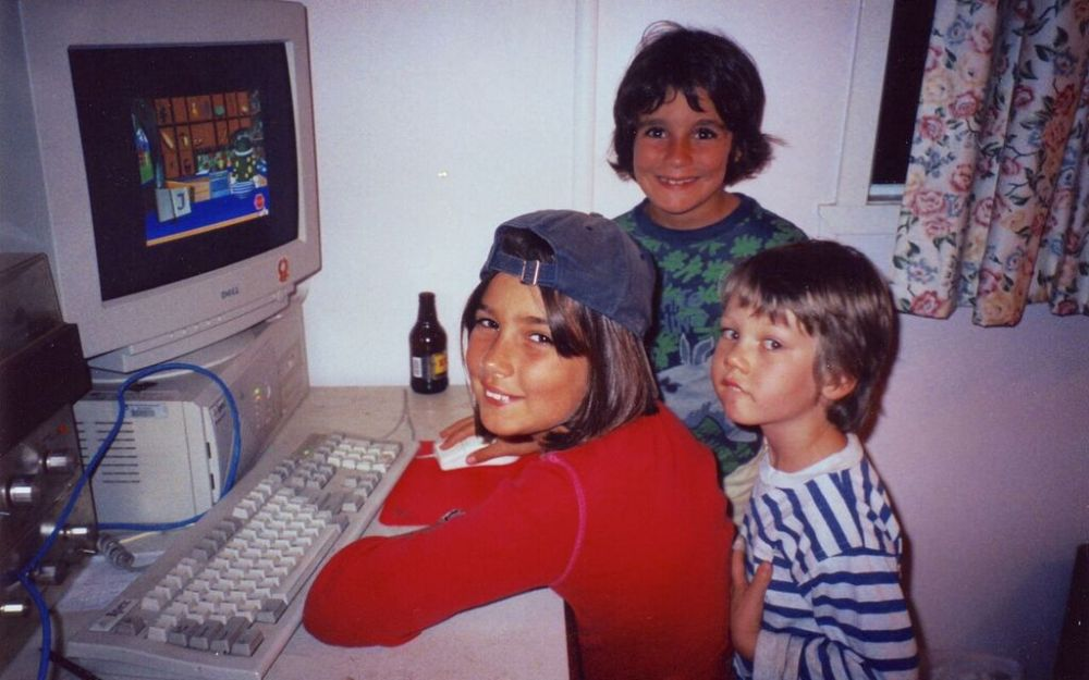 Photo of Ruby, Clare and Seamus playing computer games