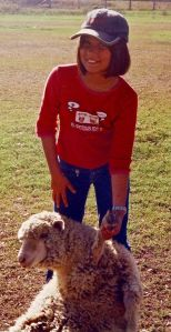Photo of Ruby holding a sheep